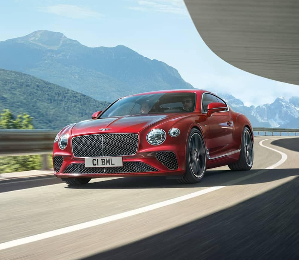 New Inventory - Red Bentley on mountain road