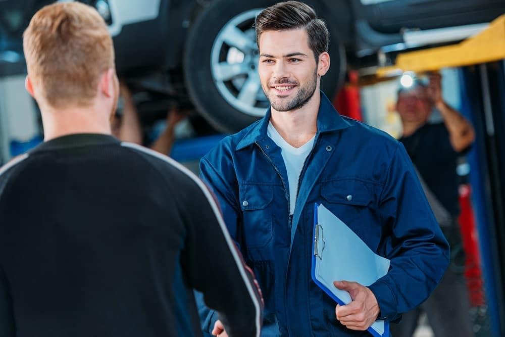 Handsome auto service mechanics
