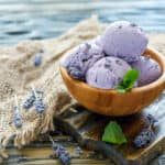Delicious lavender ice cream in a wooden bowl.