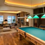 Pool table at the back of a home's living area