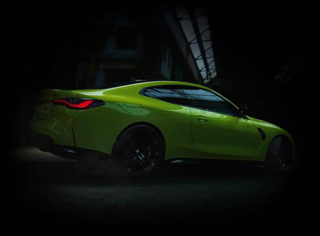 green BMW M4 in shadow