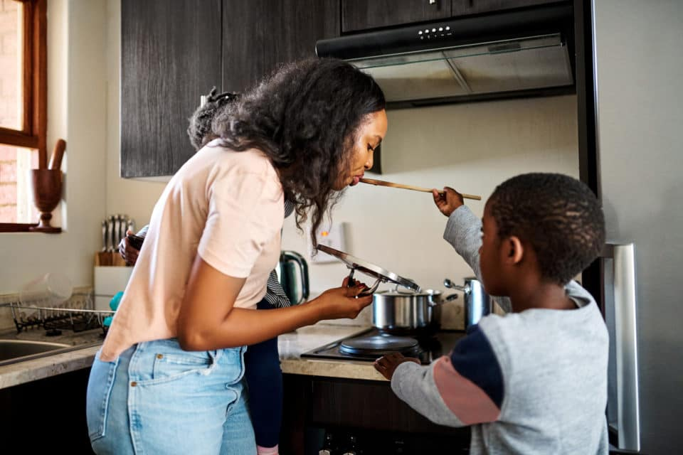 Mom and son preparing a meal together in their kitchen.