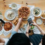 Friends taking photos of their meal before they eat