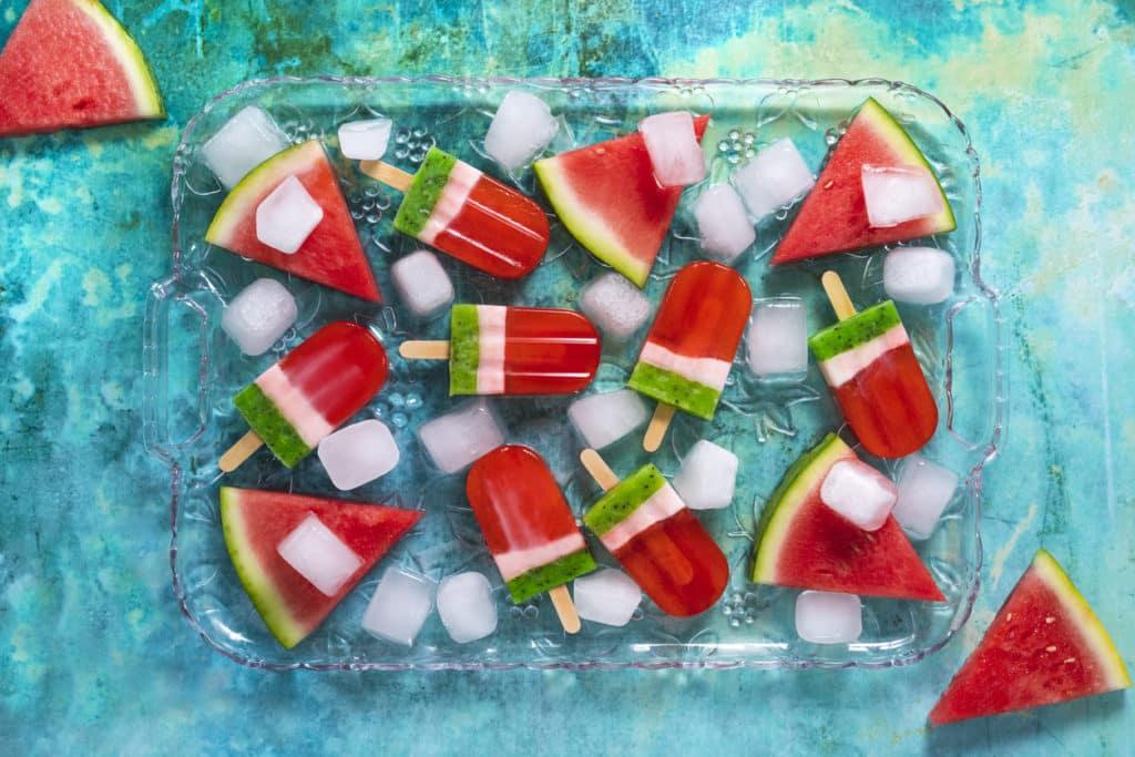 overhead view of watermelon kiwi pops in glass dish