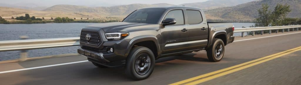 Toyota Tacoma Dark Gray Road Driving