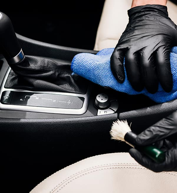 How to clean your car's interior at Boch Toyota in North Attleborough | Man wiping the interior of a car