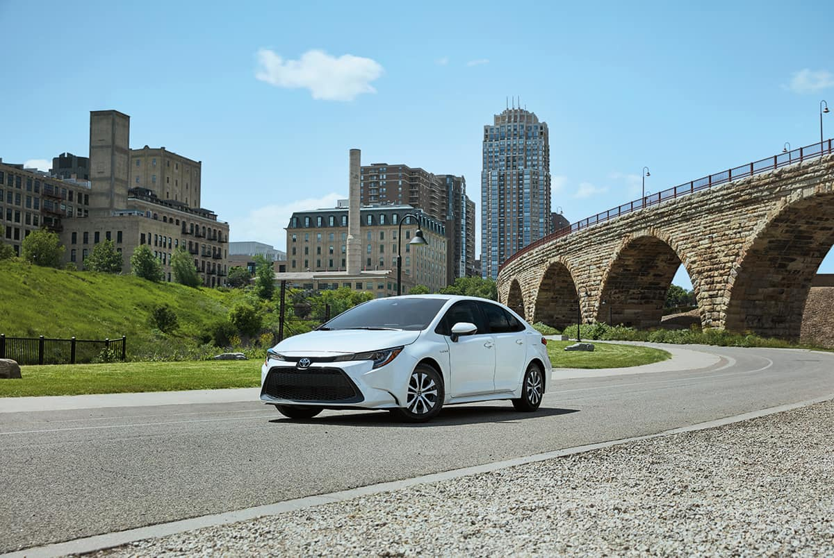 A Hybrid for Everyone at Boch Toyota | white  2020 toyota corolla hybrid running on road