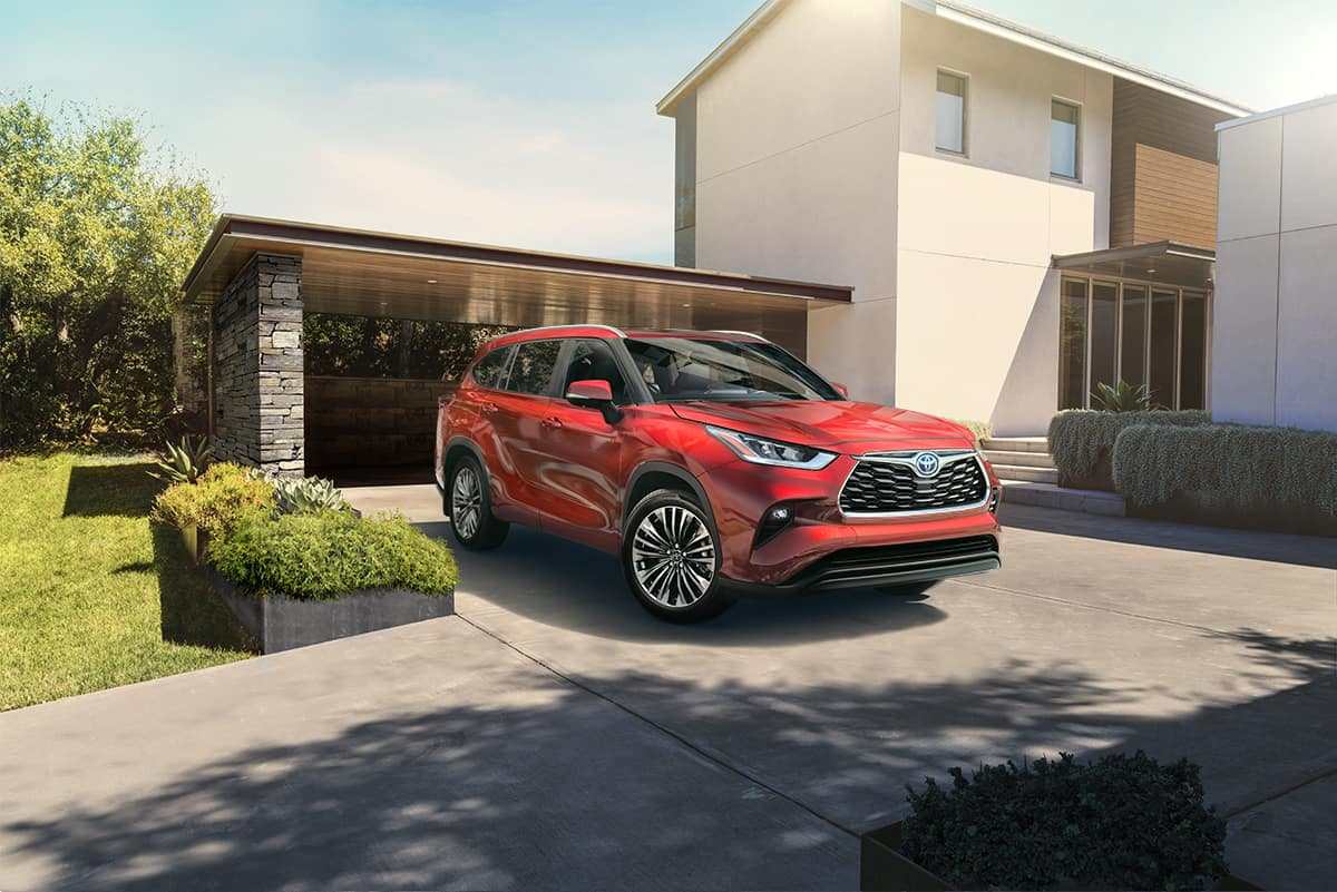A Hybrid for Everyone at Boch Toyota | red 2019 toyota Highlander hybrid park outside a building