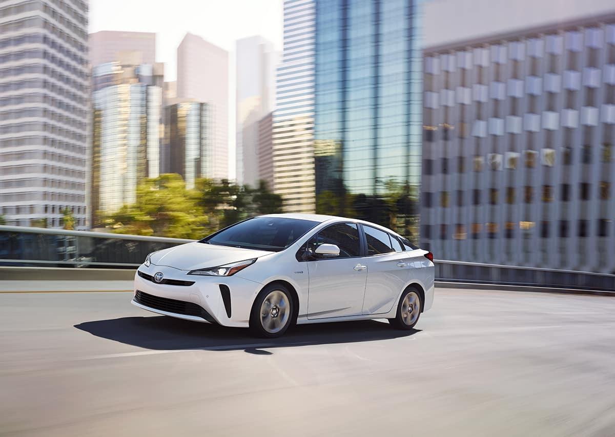 A Hybrid for Everyone at Boch Toyota | white 2019 toyota prius hybrid running on road