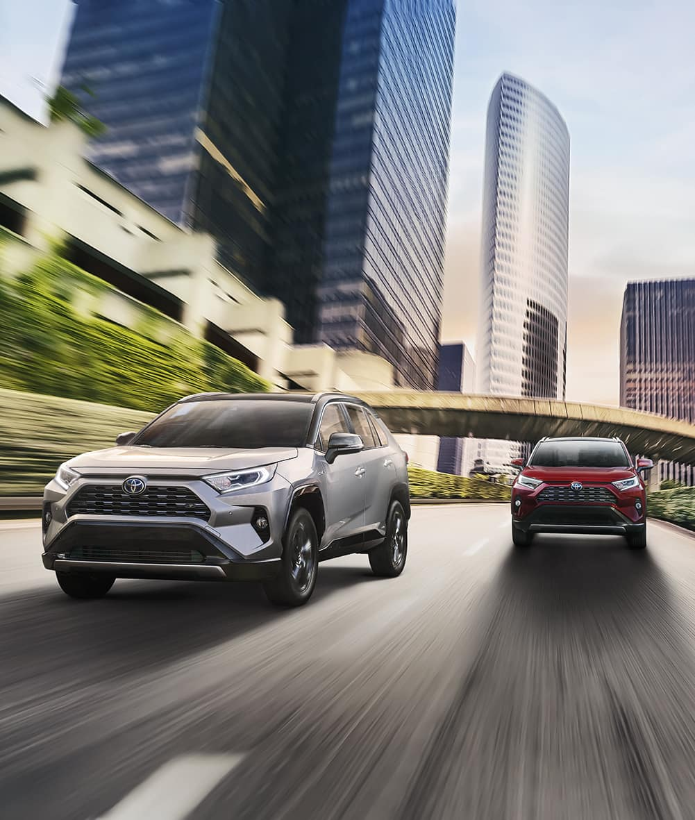 A Hybrid for Everyone at Boch Toyota | two 2019 toyota rav4 hybrid running on road
