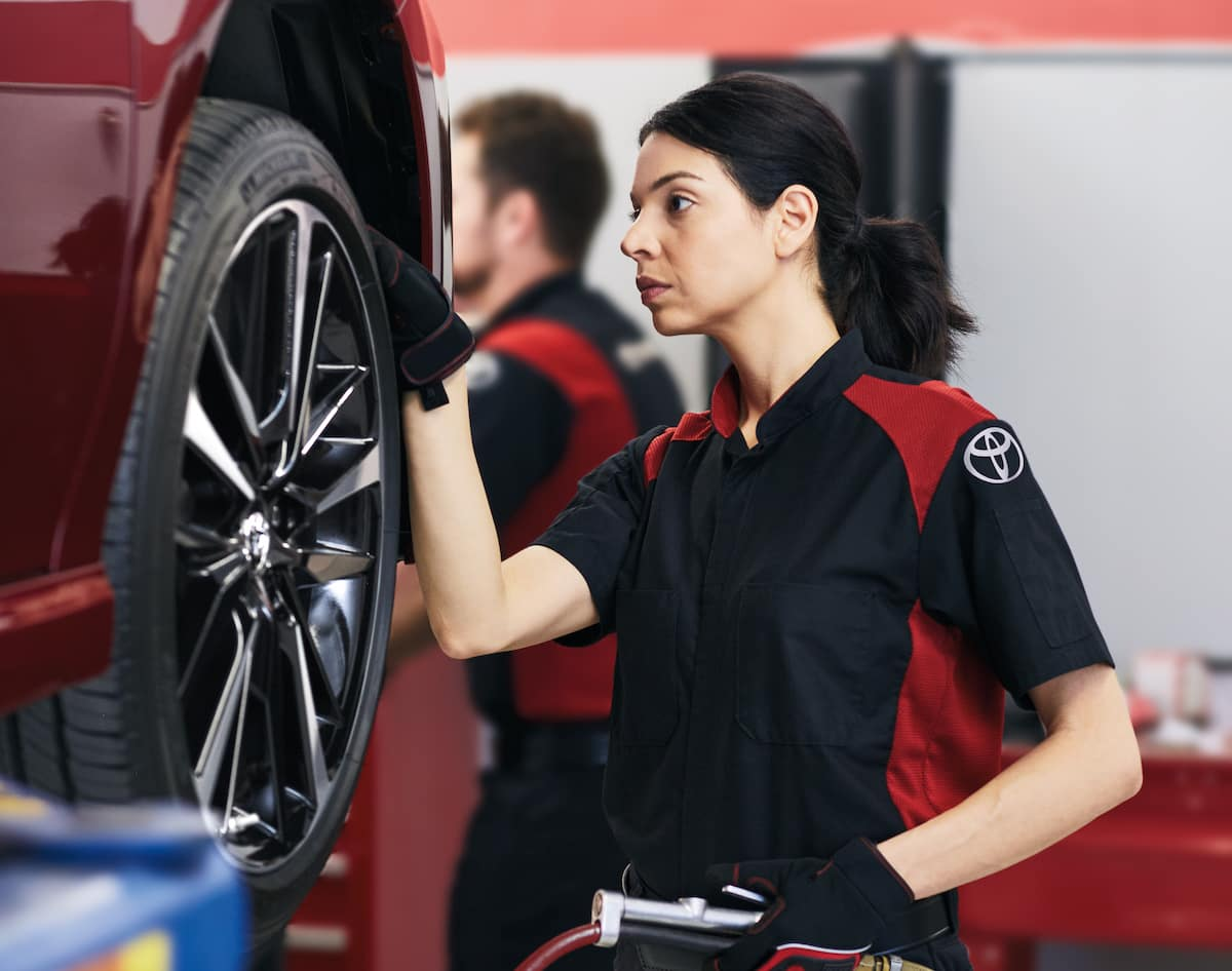 How to prepare your Toyota for the winter season | Woman technician checking car tire