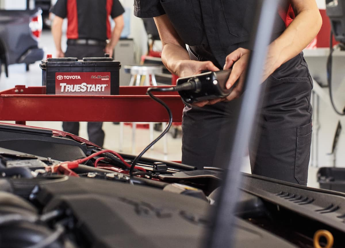 How to prepare your Toyota for the winter season | technician checking car battery