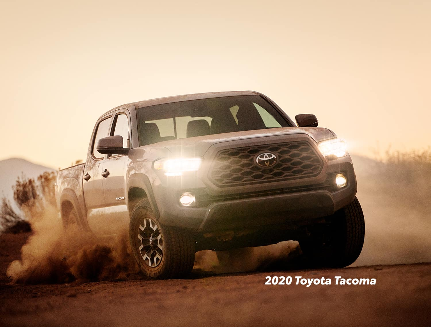 Comparison of the Toyota Tacoma vs. Tundra at Boch Toyota of Norwood | 2020 tacoma cover in dust