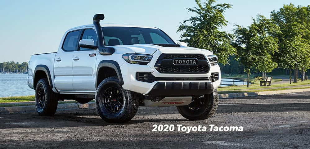 Comparison of the Toyota Tacoma vs. Tundra at Boch Toyota of Norwood | 2020 tacoma park in a lot
