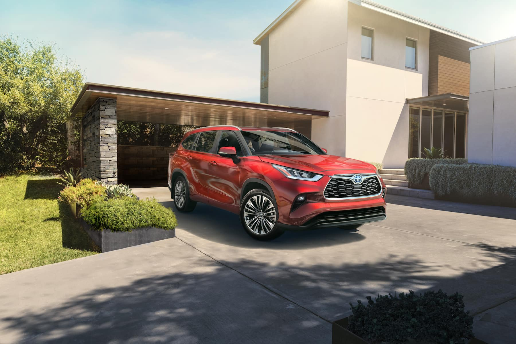 A Toyota Hybrid for Everyone: Quick Facts at Boch Toyota | the 2020 highlander hybrid parked in driveway