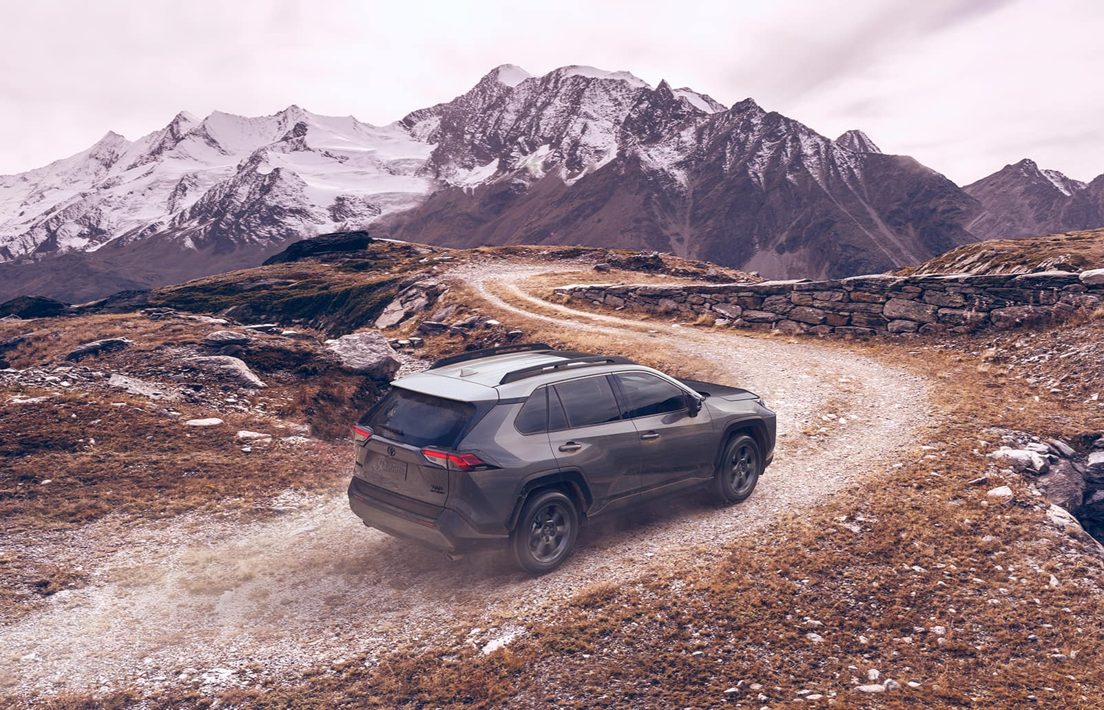 Performance features of the 2020 Toyota RAV4 at Boch Toyota   grey 2020 drving up the hill