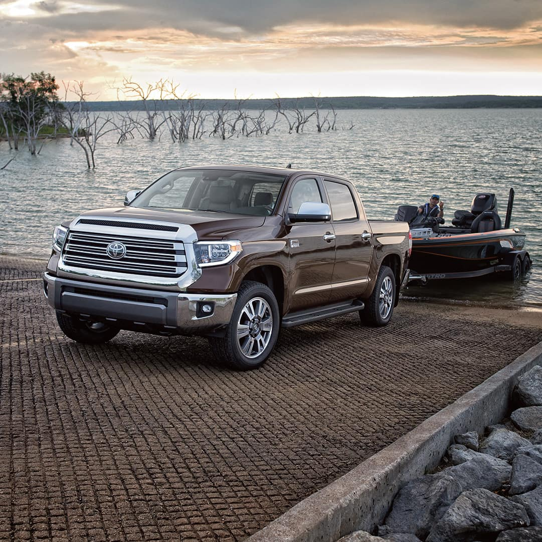 The 2020 Toyota Tundra model features at Boch Toyota in Norwood   Brown MY20 Tundra towing a small boat out of water