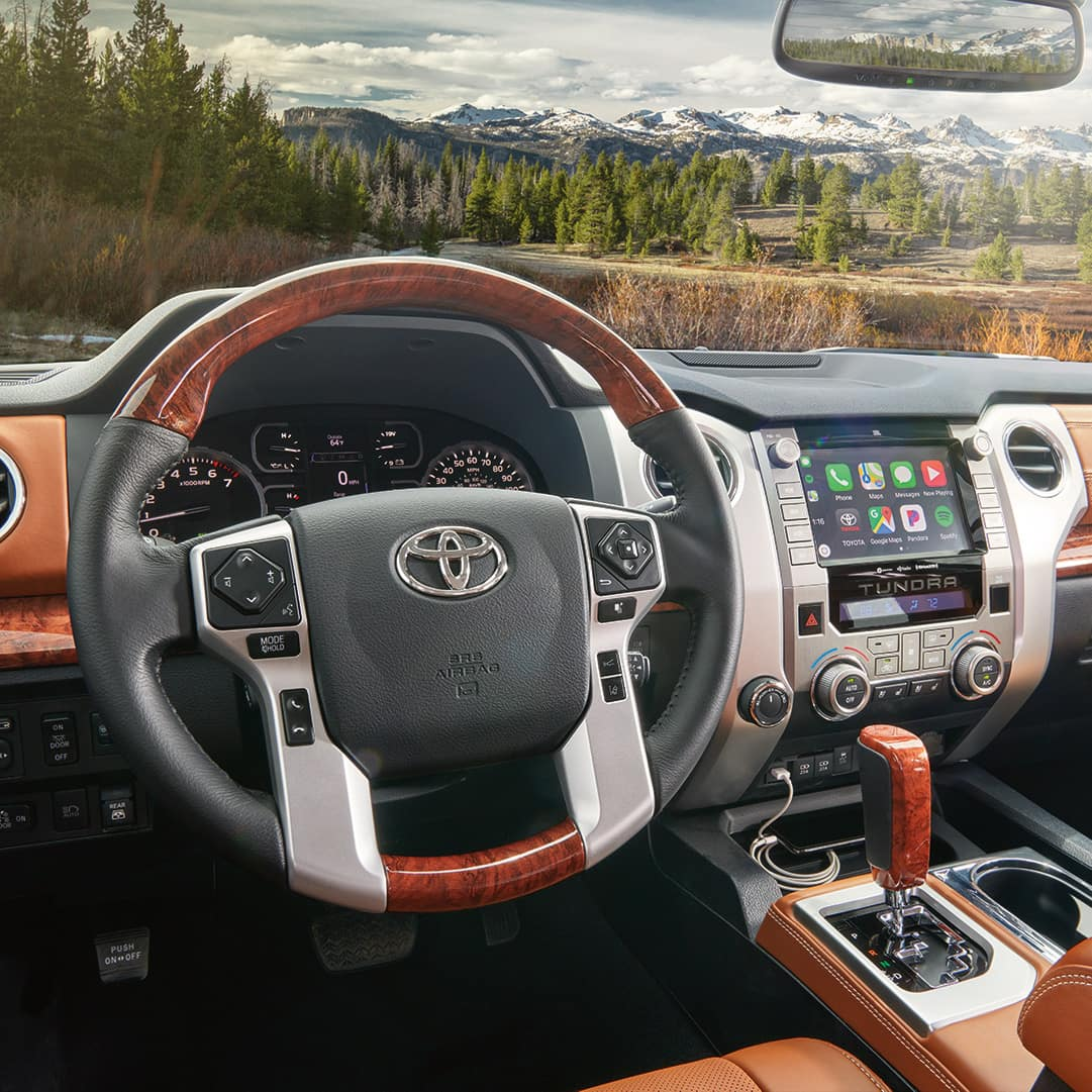 The 2020 Toyota Tundra model features at Boch Toyota in Norwood   Interior of the MY20 Tundra with wooded mountain landscape in background