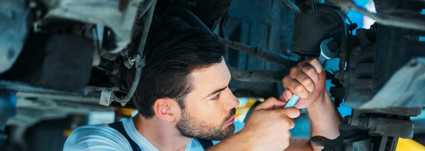 mechanic working on lifted model