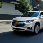 2020 chevrolet traverse white exterior driving on road