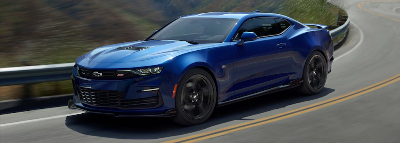 2020 chevy camaro blue exterior driving down scenic road