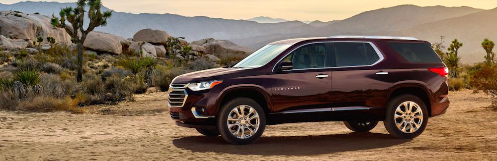 2020 chevy traverse maroon exterior parked in desert