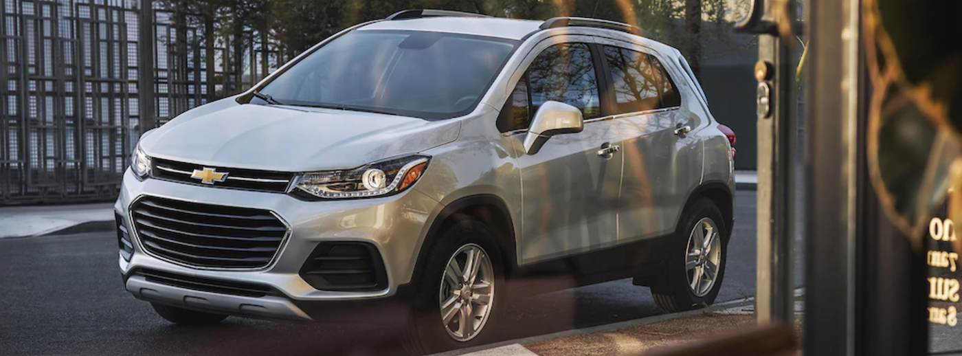 2021 chevy trax silver exterior parked outside through window view