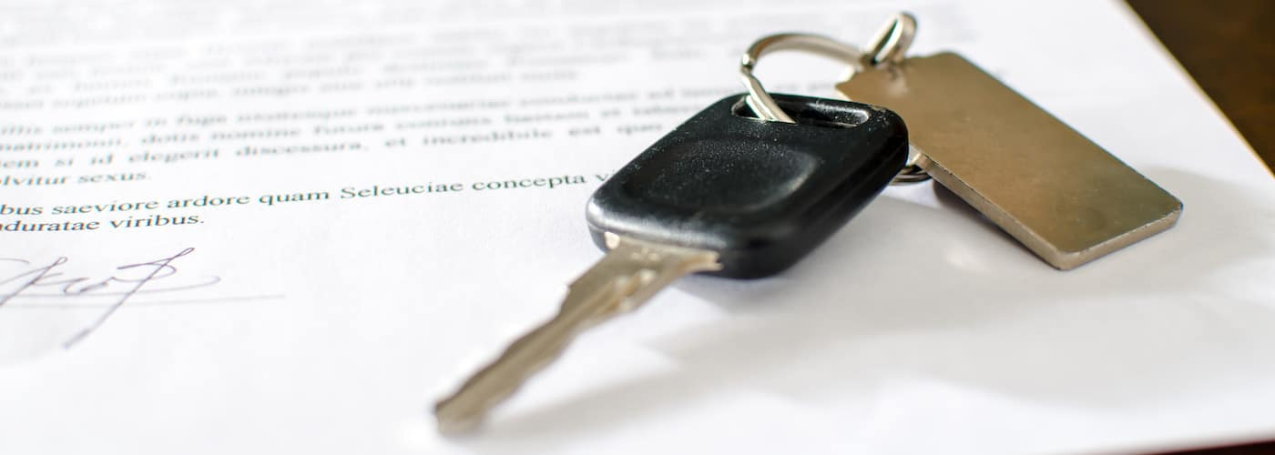 car contract and close up of key fob