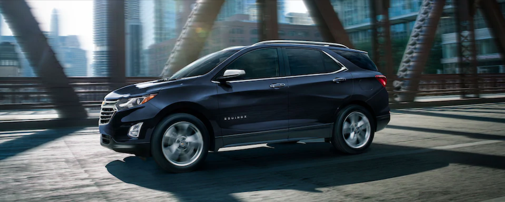 2021 chevy equinox blue exterior driving down road