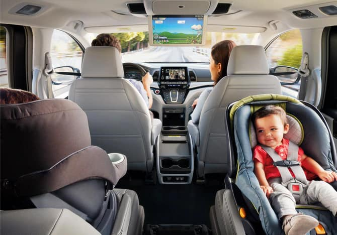 Family Drivng in Honda Odyssey with Rear Entertainment System