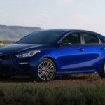 2020 kia forte blue exterior parked in field