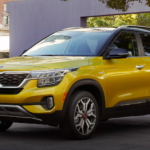 2021 kia seltos yellow exterior modle parked outside