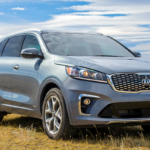 2020 kia sorento blue exterior parked in field during day