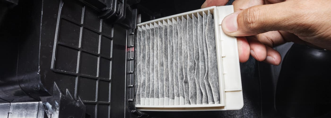 close up of cabin air filter being changed