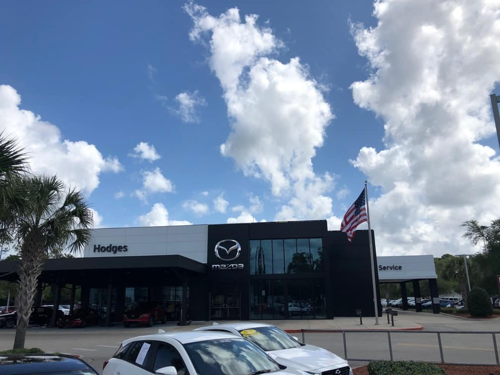dealership with blue sky and clouds