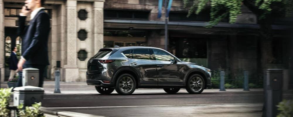 2020 Grey Mazda CX-5 near a busy town