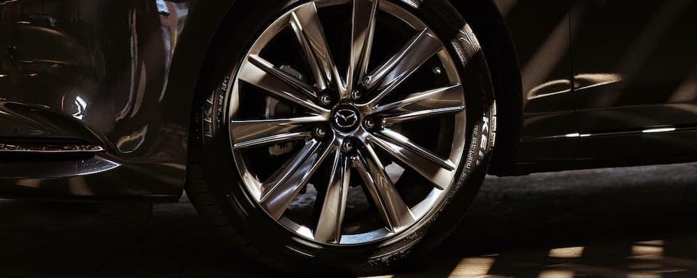 Mazda tires on a black vehicle