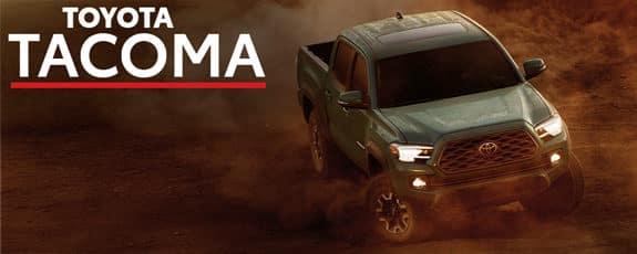 2021 Toyota Tacoma driving through dirt