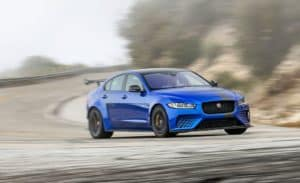 Blue 2019 Jaguar XE SV Project 8 Rounding Mountain Curve