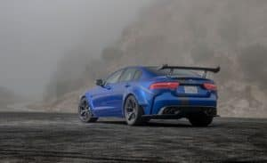 2019 Jaguar XE SV Project 8 with back facing viewer showcasing rear spoiler