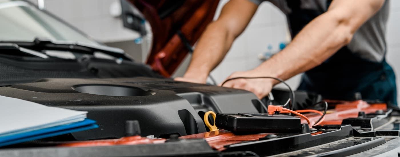 man-installing-car-battery