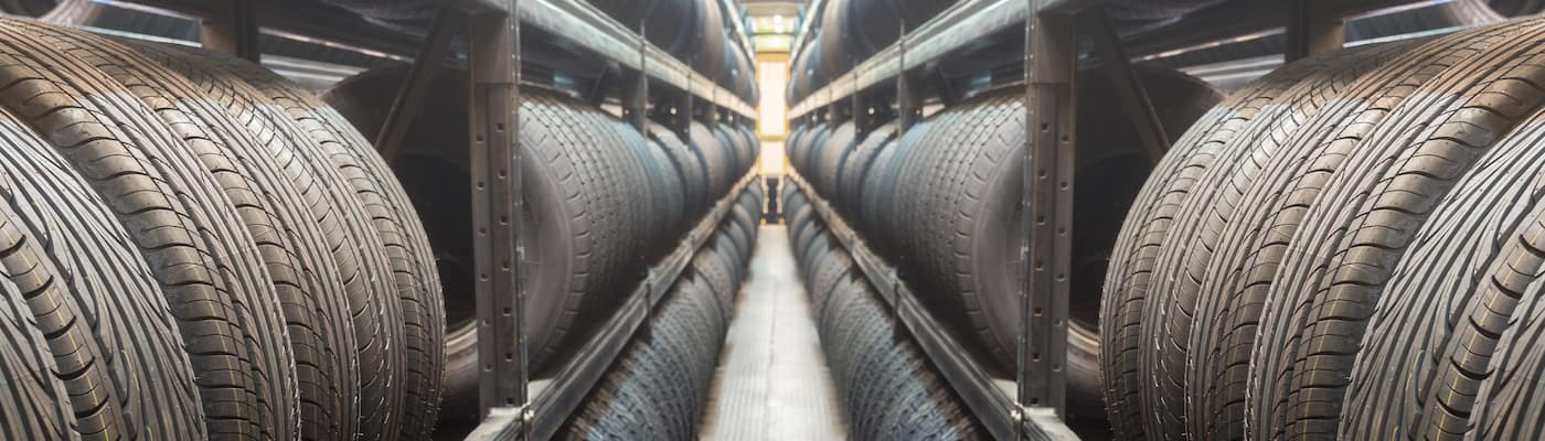 Racks of tires lined up inside a tire warehouse