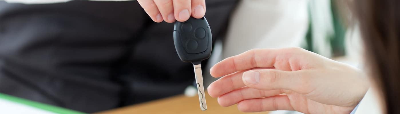Finance adviser handing car keys to customer