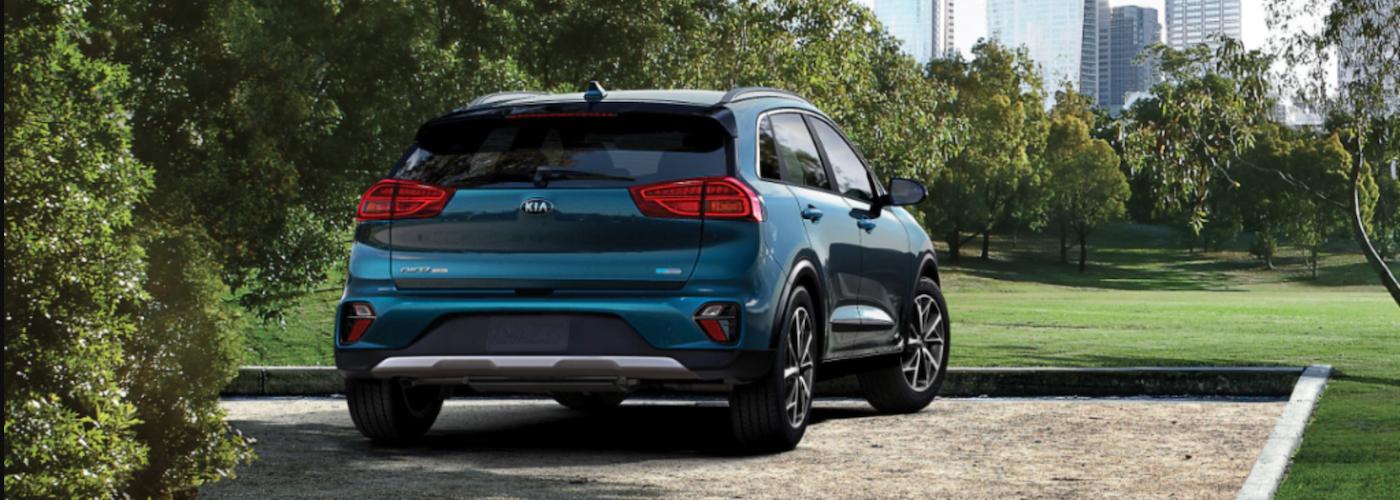 2020 kia niro hybrid blue exterior parked outside city skyline
