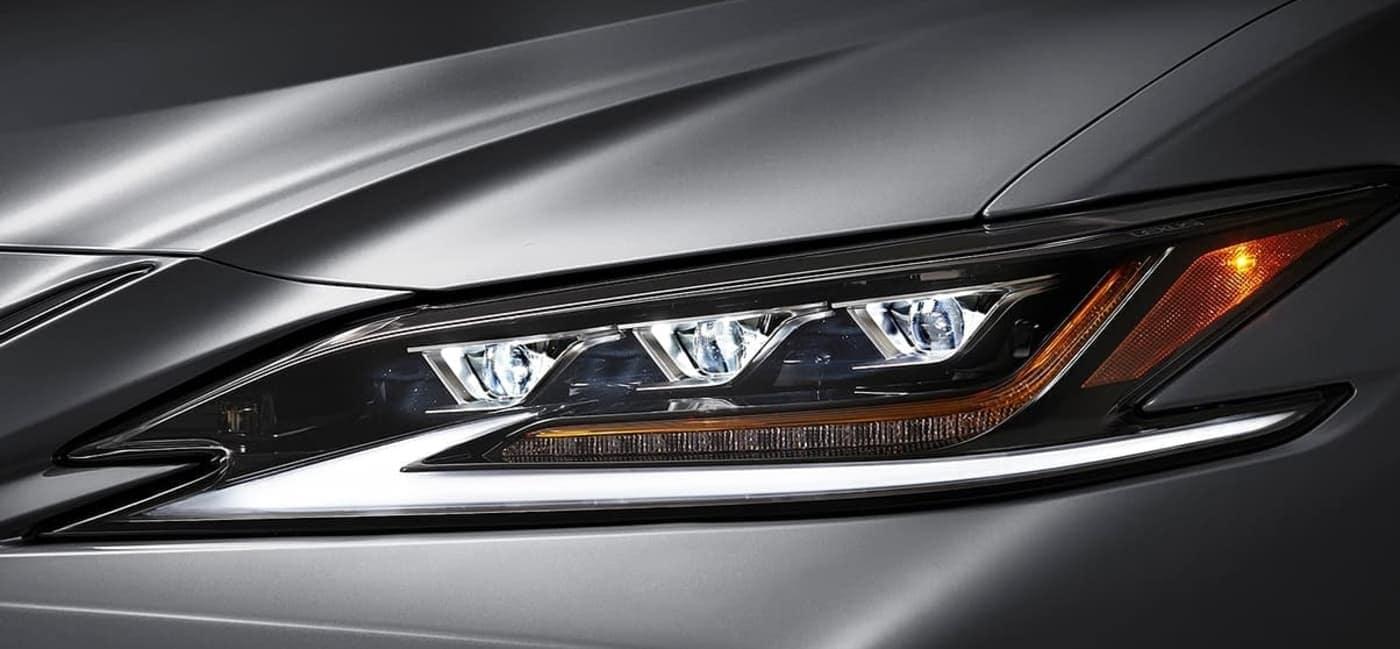 https://di-uploads-pod23.dealerinspire.com/lexusofchattanooga/uploads/2019/06/2020-Lexus-ES-headlamp-close-up.jpg