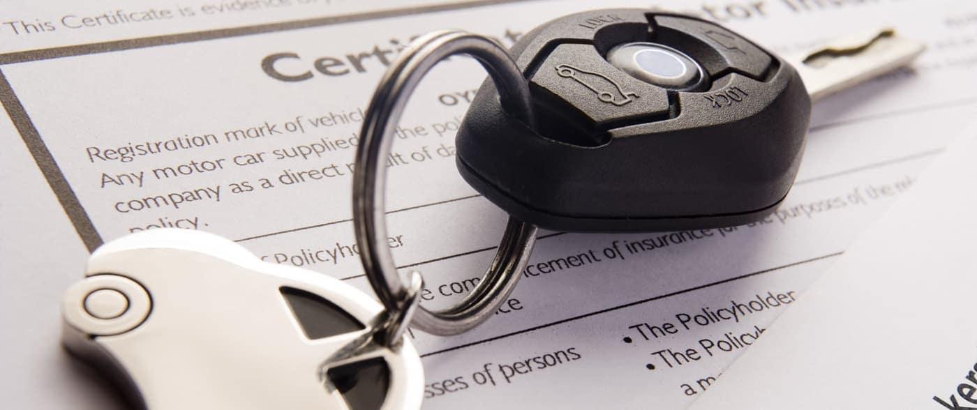 insurance paperwork with car keyn