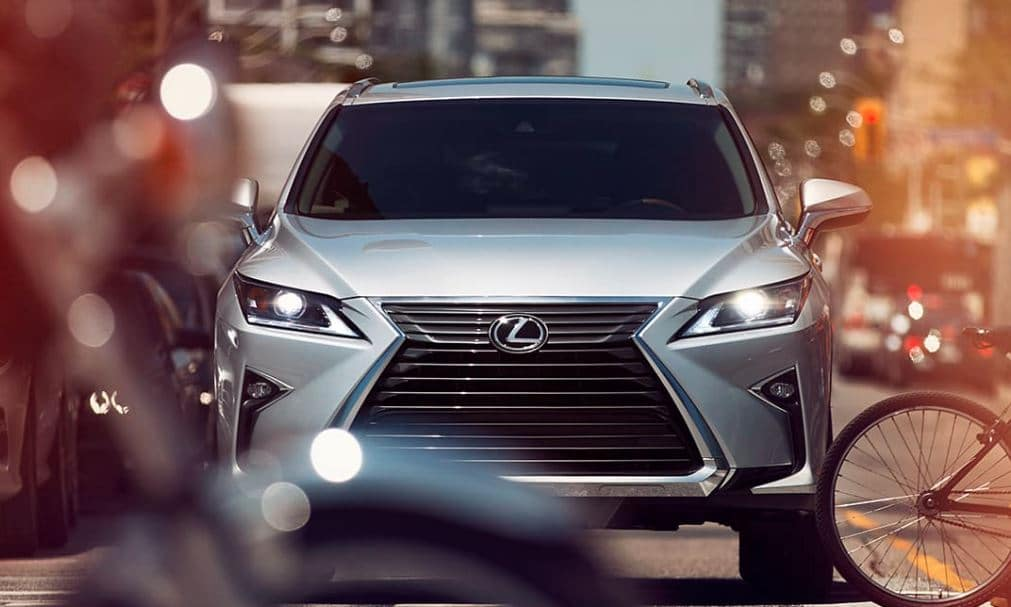 Lexus RX 2019 model seen head on in busy traffic large city showing value of technology features