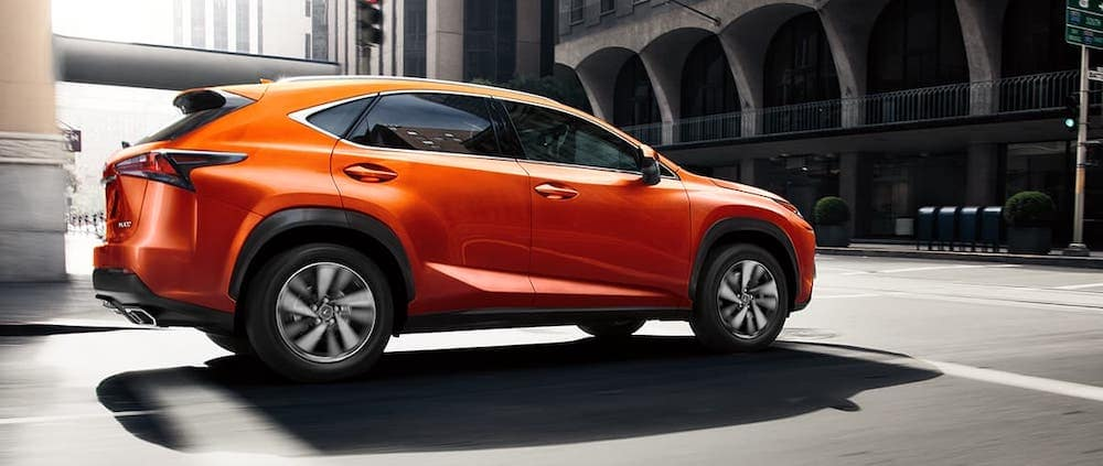 2020 lexus nx red orange exterior driving on city road