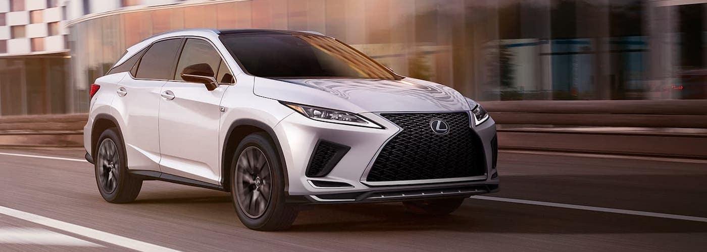 2020 lexus rx white exterior driving down road