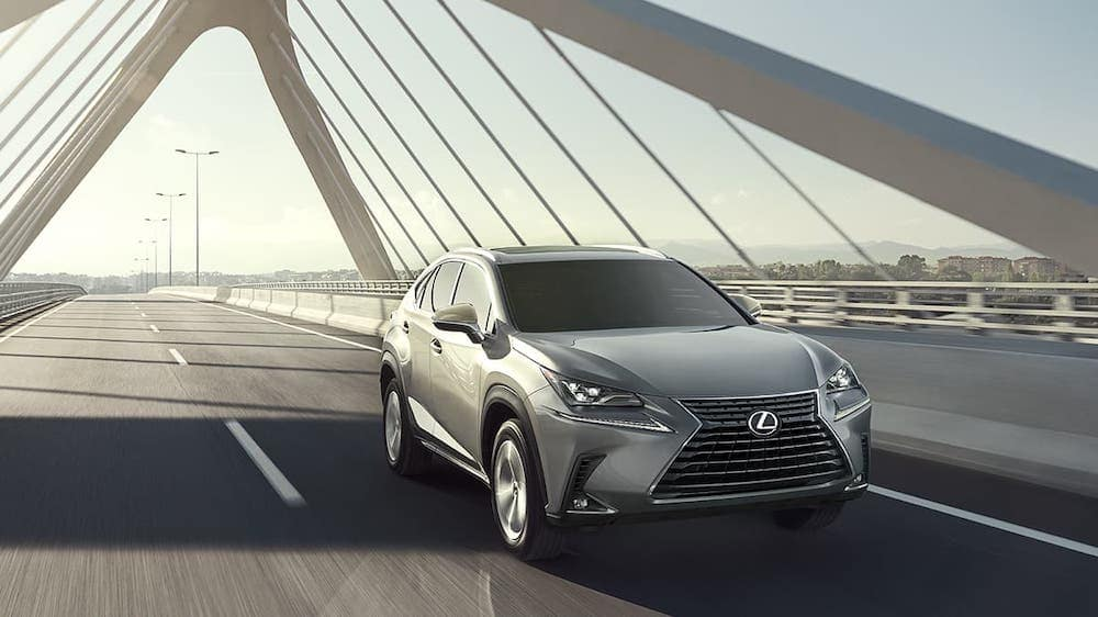 2020 Lexus NX driving on a bridge
